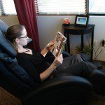 Woman Reading Magazine in Massage Chair