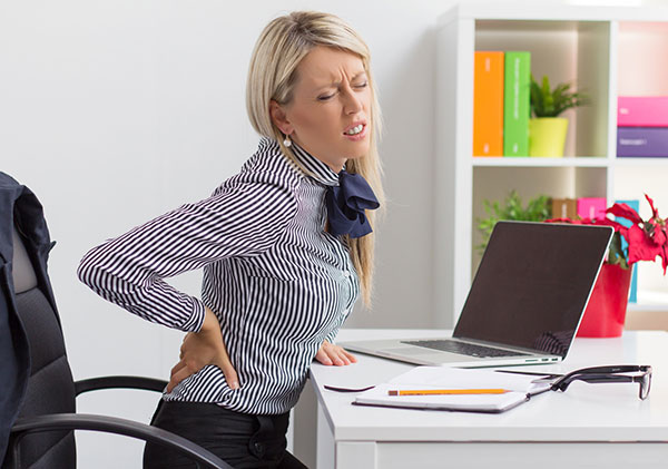 Office Worker with Severe Back Pain